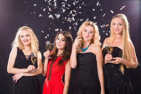 Photo for Party, holidays, celebration and nightlife concept - smiling female friends with glasses of champagne in club - Royalty Free Image