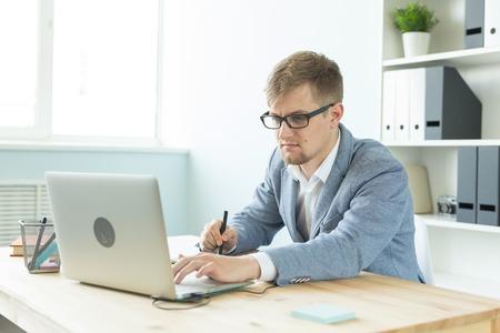 Foto für Designer, artist and web design concept - Portrait of young man using digital pen tablet and laptop in the office - Lizenzfreies Bild