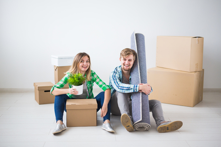 Photo for Relocation, new home and real estate concept - Young couple upacking in their new flat together - Royalty Free Image