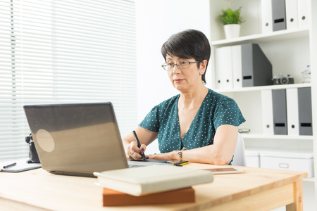 Foto für Business, technology and people concept - happy woman using graphics tablet - Lizenzfreies Bild