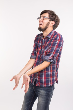 Foto de Emotions and people concept - bearded man confused and scared something, looks like he guilty - Imagen libre de derechos