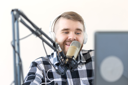 Photo for Podcasting, music and radio concept - young dj at radio studio - Royalty Free Image