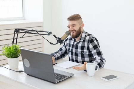 Photo for Streamer, blogger and media concept - radio dj working at studio - Royalty Free Image