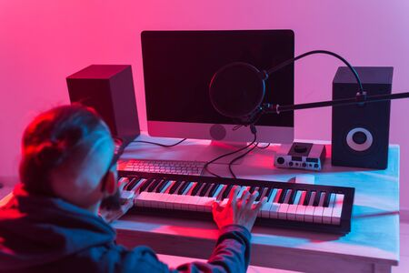 Photo for Musician and making music concept - Male sound producer working in recording studio. - Royalty Free Image