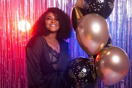 Photo for Beautiful black woman enjoying a party lifestyle. Birthday party, clubbing and holidays concept. - Royalty Free Image
