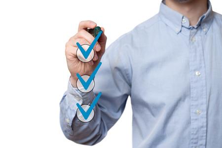 Photo pour businessman checking mark checklist marker Isolated on  white background - image libre de droit