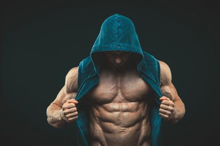 Foto de Man with muscular torso. Strong Athletic Man Fitness Model Torso showing six pack abs - Imagen libre de derechos