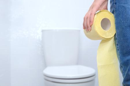 Foto de Close-up of woman on toilet. - Imagen libre de derechos