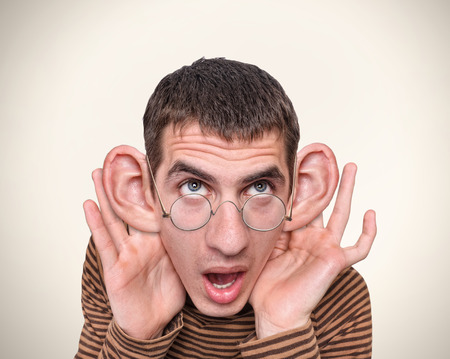Photo pour Man listening with big ears - image libre de droit