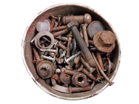 Foto de Metalic box with rusty screws and nuts, isolated on white - Imagen libre de derechos
