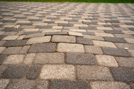 Photo for incorrectly laid paving slabs. holes and bumps in the road, uneven sidewalk. - Royalty Free Image