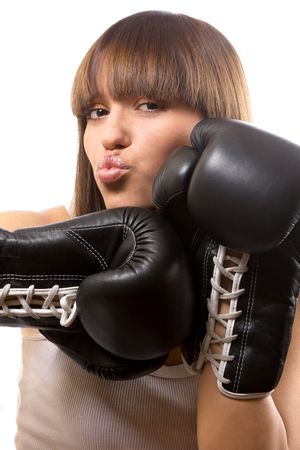 portrait of sexy brunette with boxing gloves over white