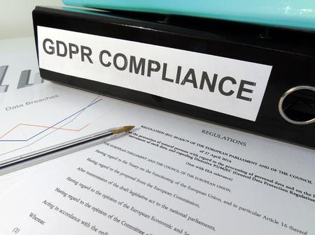 Foto de General Data Protection Regulation (GDPR) Compliance Lever Arch Folder on Cluttered Desk - Imagen libre de derechos