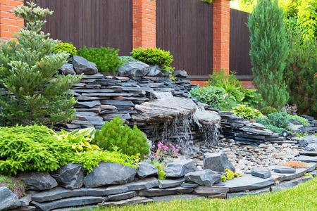 Foto de Natural stone landscaping in home garden - Imagen libre de derechos