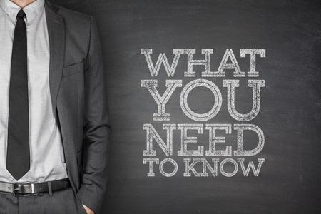 Foto de What you need to know on blackboard with businessman - Imagen libre de derechos