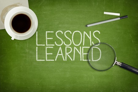Photo for Lessons learned concept on green blackboard with coffee cupt and paper plane - Royalty Free Image