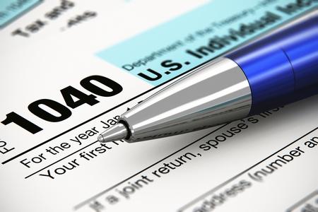 Photo pour Tax form business financial concept  macro view of individual return tax form and blue metal ballpoint pen - image libre de droit