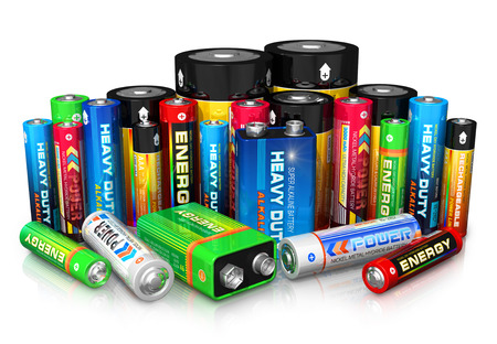 Foto de Group of different size color batteries isolated on white background with reflection effect  Design is my own and all text labels are fully abstract - Imagen libre de derechos