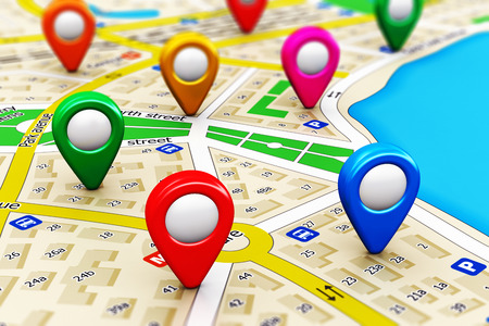 Foto de Creative abstract GPS satellite navigation, travel, tourism and location route planning business concept: macro view of color city map with group of colorful destination pointer marker icons with selective focus effect - Imagen libre de derechos