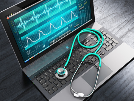 Foto de Creative abstract healthcare, medicine and cardiology tool concept: laptop or notebook computer PC with medical cardiologic diagnostic test software on screen and stethoscope on black wooden business office table - Imagen libre de derechos