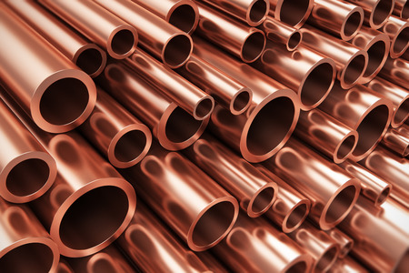 Foto de Creative abstract heavy non-ferrous metallurgical industry and industrial manufacturing business production concept: heap of shiny metal copper pipes with selective focus effect - Imagen libre de derechos