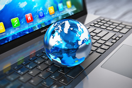 Photo for Creative abstract global computer communication and internet business telecommunication concept: macro view of crystal Earth globe on laptop or notebook keyboard with selective focus effect - Royalty Free Image