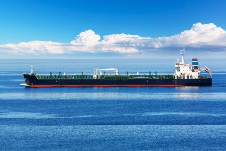 Photo pour Creative absract old and gas industry and sea transportation, shipping and logistics business trading commerce concept: Industrial oil and chemical commercial tanker ship vessel in blue ocean - image libre de droit
