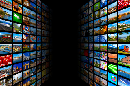 Foto de Creative abstract web streaming media TV video technology and multimedia business internet communication concept: black background with endless walls of screens with color photos and colorful displays with different images - Imagen libre de derechos