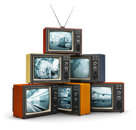 Foto de Creative abstract communication media and television channel broadcasting business concept: stack or pile of old retro color wooden home TV receiver sets with antenna isolated on white background - Imagen libre de derechos