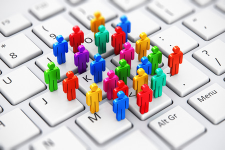 Creative abstract social media, internet communication and business marketing corporate web concept: macro view of group of 3D color people figures on white laptop or notebook computer PC keyboard with selective focus effect