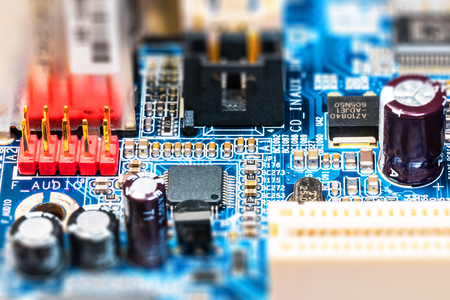 Foto de Creative abstract electronic industry business technology concept: macro view of computer PC motherboard or mainboard circuit board PCB with selective focus effect - Imagen libre de derechos