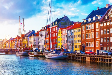 Photo for Scenic summer sunset view of Nyhavn pier with color buildings, ships, yachts and other boats in the Old Town of Copenhagen, Denmark - Royalty Free Image