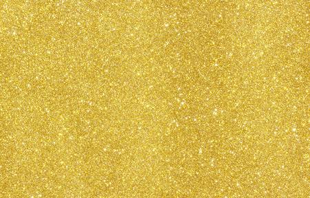 Foto de Shiny hot yellow gold foil golden color glitter decorative texture paper - Imagen libre de derechos