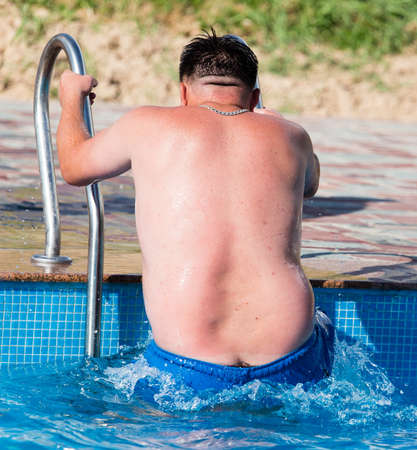 Foto de The man comes out of the pool . - Imagen libre de derechos