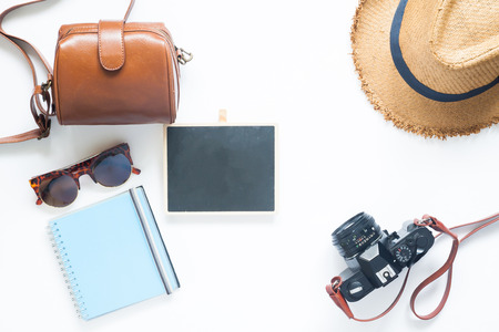 Foto de Flat lay style of summer accessories, Travel items on white background with blank board for text - Imagen libre de derechos