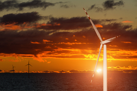 Photo for Wind generator on a background of sunset sky. Clean energy concept - Royalty Free Image