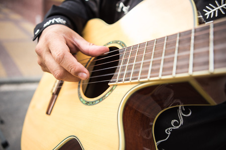 Photo for Guitarist plays the guitar. Close-up of hands - Royalty Free Image