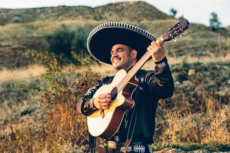Photo for Musician mariachi with guitar on the coast. - Royalty Free Image
