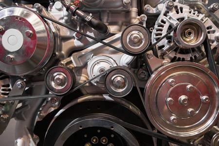 Photo pour Close up of belting in modern diesel engine - image libre de droit