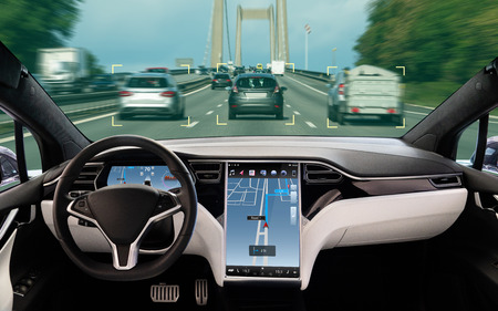 Photo pour Self driving car on a road. Autonomous vehicle. Inside view. - image libre de droit