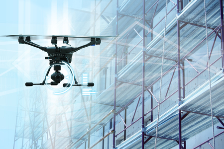Photo pour Drone on a background of a construction. Digital transformation and internet of things in construction industry. - image libre de droit