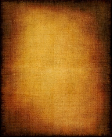 An old section of cloth and paper with a golden center and vignette effect.