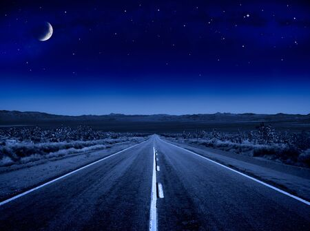 A desert road at night leading off into infinity.