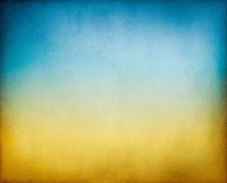 Photo pour A vintage, textured paper background with an earth to sky toned gradient. - image libre de droit