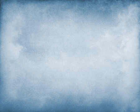Fog and clouds on a blue paper background.  Image displays a pleasing paper grain and texture at 100%.