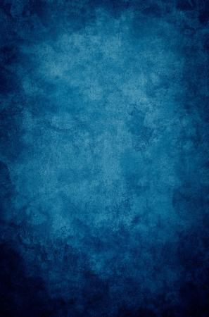 Photo pour A textured, vintage paper background with a dark blue vignette. - image libre de droit