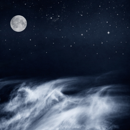 Photo for A fantasy cloudscape with a full moon and stars done in a cool-toned black and white rendition Image has a pleasing paper grain and texture when viewed at 100 percent  - Royalty Free Image