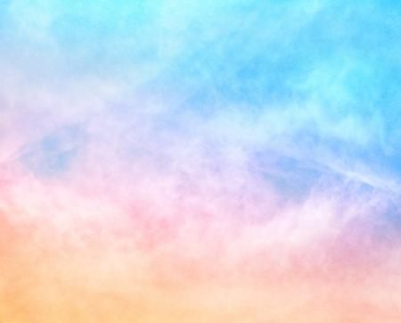 Photo pour A soft cloud with a pastel colored orange to blue gradient   Image features a pleasing paper grain and texture at 100 percent  - image libre de droit