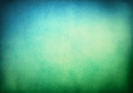 Photo pour A textured grunge background with a green to blue gradient.  Image displays significant paper grain and texture when viewed at 100 percent. - image libre de droit