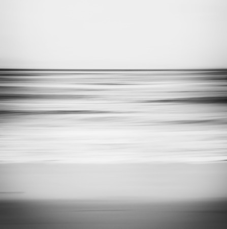 Foto de A black and white, abstract ocean seascape with blurred panning motion. - Imagen libre de derechos